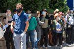 Алматинцы в масках стоят в очереди у аптеки