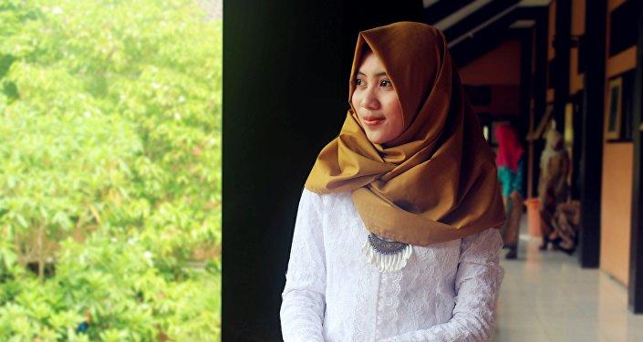 Хиджаб киген қыз