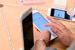 Продажа смартфонов iPhone 6s и iPhone 6s Plus, фото из архива