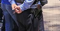 Полицейдің архивтегі фотосы