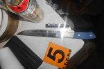Улики, изъятые у подозреваемого в вооруженном налете на магазин