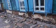 Архивное фото разрушающегося дома