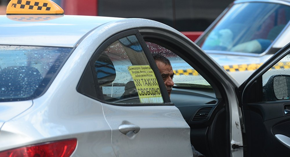 Водитель такси, архивное фото