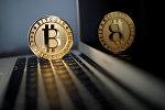 Монета биткоин. Иллюстративное фото