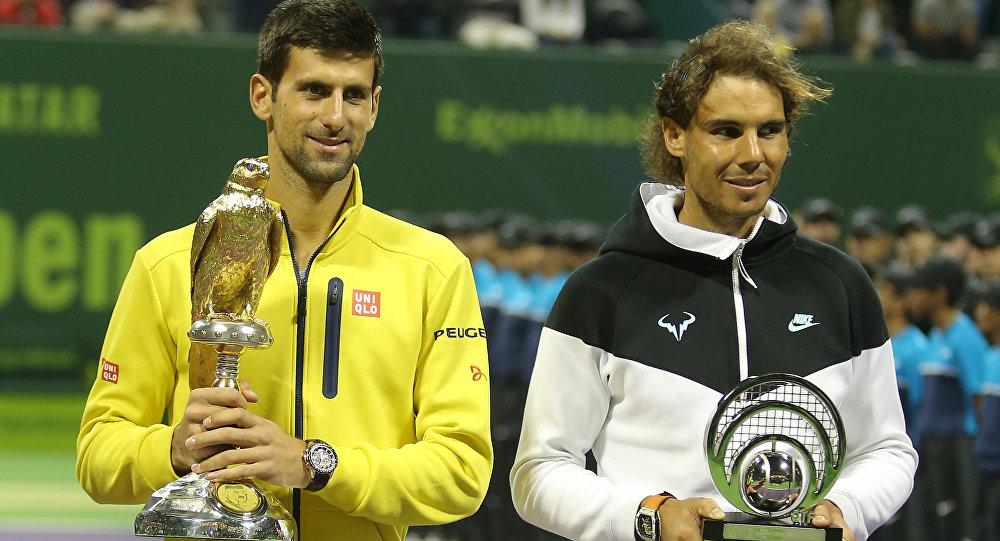 Легенды тенниса - испанец Рафаэль Надаль и серб Новак Джокович , архивное фото