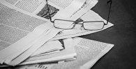 Очки и газеты