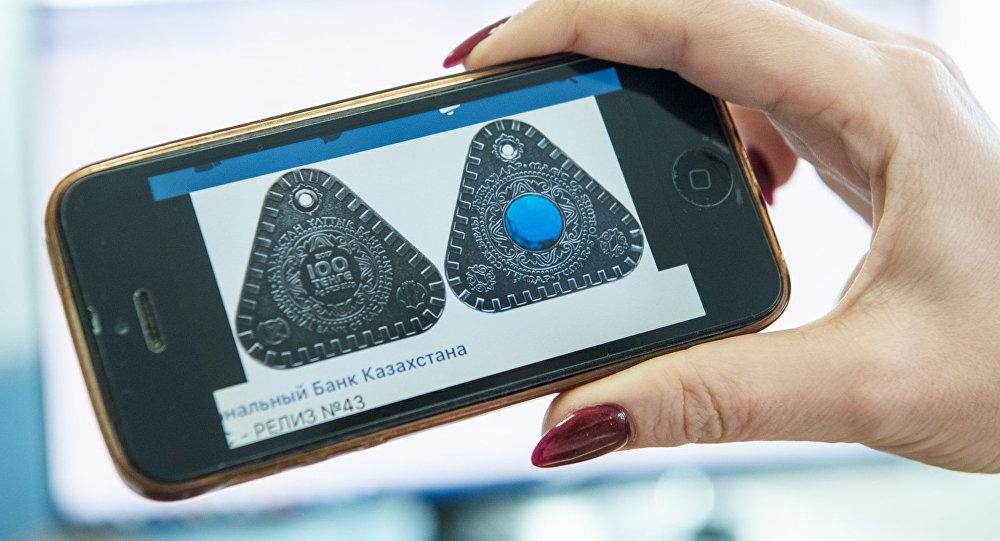 Изображение монет Тумар с сотового телефона
