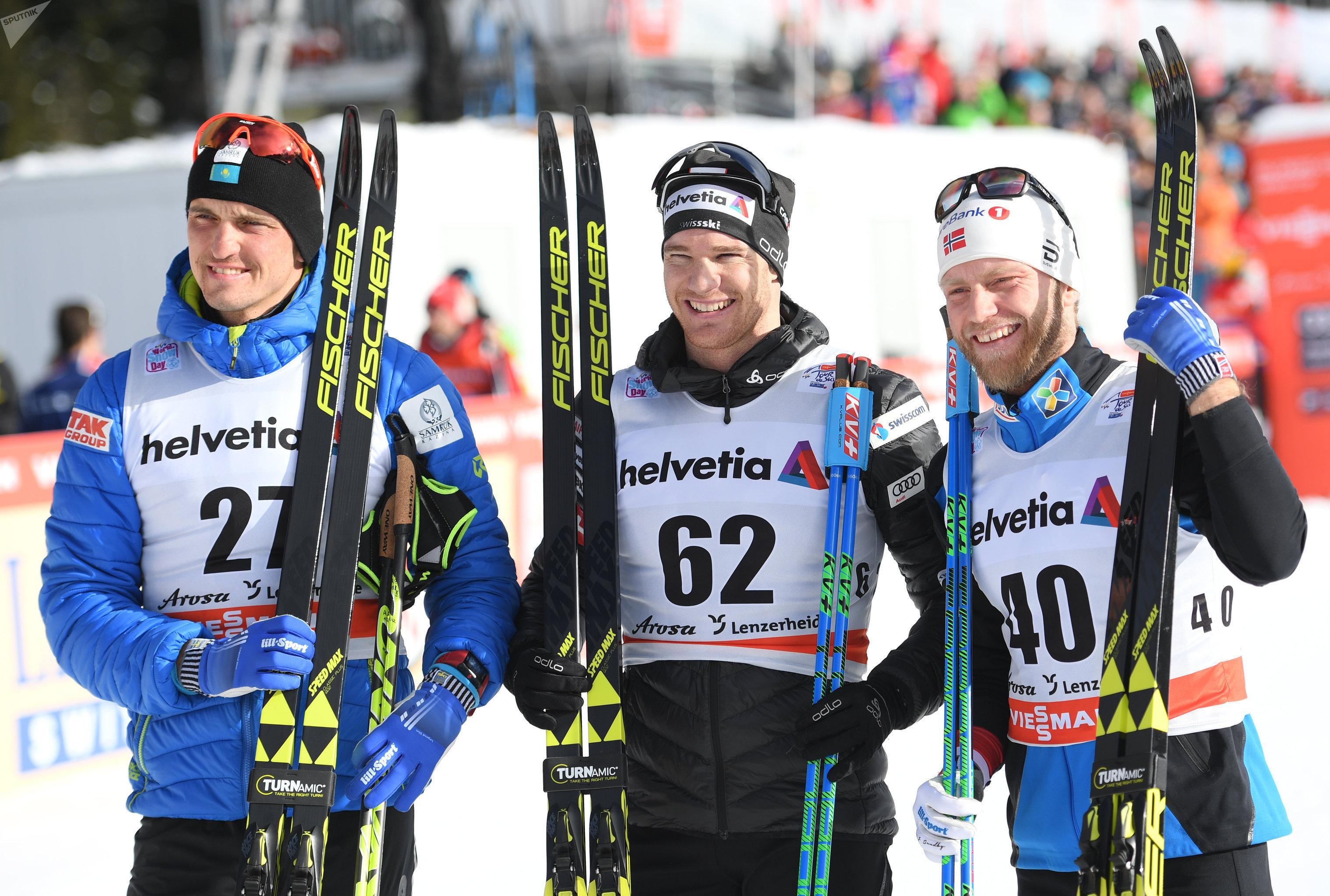 Призеры гонки на 15 км классическим стилем Тур де Ски (слева направо): Алексей Полторанин, Дарио Колонья, Мартин Йонсруд Сундбю