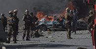 Персонал афганских сил безопасности на месте нападения террористов в Кабуле, архивное фото