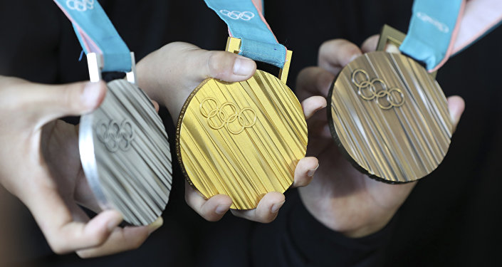 Олимпиада медалі, архивтегі сурет