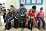 Очередь на прием к педиатру в детской поликлинике, архивное фото