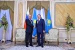 Президент РФ Владимир Путин и президент Казахстана Нурсултан Назарбаев, архивное фото