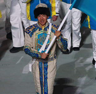 Ердос Ахмадиев во время парада атлетов на церемонии открытия XXII зимних Олимпийских игр в Сочи, архивное фото