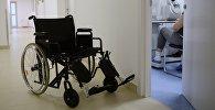 Инвалидная коляска, архивное фото