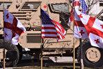 Флаги Грузии и США в совместном центре тренировок и оценок Грузия-НАТО (JTEC)