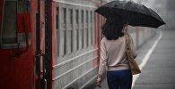 Девушка во время дождя