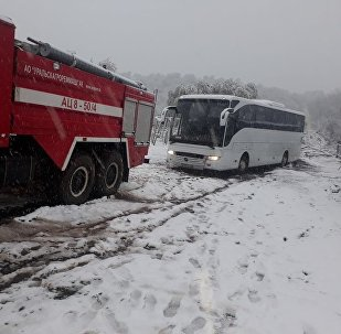 В Алматинской области спасатели отбуксировали два автобуса из грязевой массы