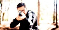 Мужчина с ружьем, иллюстративное фото