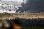 Столкновения между израильскими силами и палестинскими протестующими на границе с сектором Газа