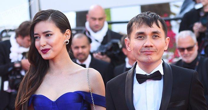 Казахстанский сценарист и режиссер Адильхан Ержанов и актриса Динара Бактыбаева
