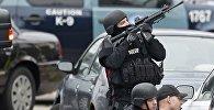 Полиция Бостона в поисках подозреваемого в теракте, совершенного 15 апреля 2013 года в центре города недалеко от финишной черты проходившего традиционного марафона