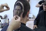 Сербский парикмахер выбрил на затылке клиента портрет Роналду