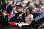 Принц Гарри и герцогиня Меган во время парада в честь дня рождения королевы Елизаветы II