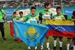 Двенадцатилетний футболист из Алматы Алан Адахаев вынес флаг Казахстана на ЧМ-2018