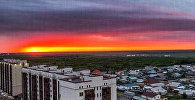 Живописный алый закат в Астане
