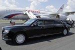 Президентский служебный автомобиль Aurus Senat президента РФ Владимира Путина во время встречи в аэропорту Хельсинки, 16 июля 2018
