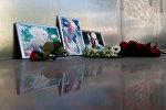Фотографии журналистов, погибших в Центрально-Азиатской Республике Орхана Джемаля, Кирилла Радченко и Александра Расторгуева (справа налево)