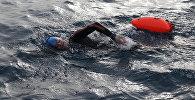Участник международного заплыва Issyk-Kul Swim Challenge