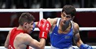 Казахстанский боксер Асланбек Шымбергенов (справа)