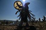 Проведение шаманского ритуала, архивное фото