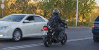 Мотоциклист, архивное фото