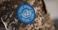 Шевроны голубого цвета с символикой ООН