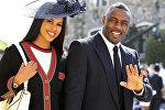 Британский актер Идрис Эльба и модель Сабрина Дауре прибывают на церемонию бракосочетания принца Гарри и Меган Маркл в часовню Святого Георгия в Виндзорском замке в Виндзоре, архивное фото
