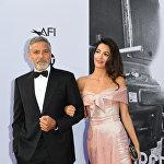 Американский актер Джордж Клуни и его жена Амаль Клуни