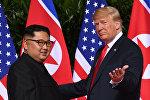 Ким Чен Ын и Дональд Трамп, архивное фото