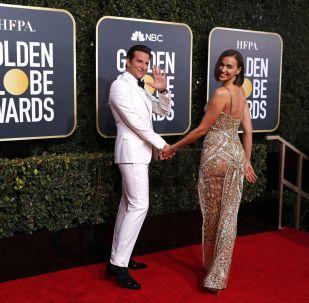 Актер Брэдли Купер и модель Ирина Шейк на церемонии вручения премии Золотой глобус в Калифорнии