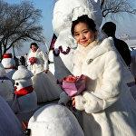 Невеста на фестивале ледовых скульптур в Харбине