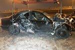 BMW снес забор, водитель и пассажир скрылись