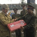 Вывод советских войск из Афганистана. Советские военные передают афганским товарищам символический ключ от Н-ской части ограниченного контингента советских войск в Афганистане