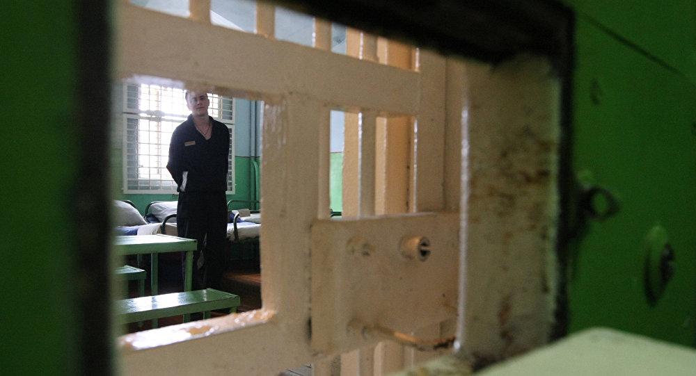 Архивное фото заключенного в камере
