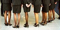 Девушки в деловых костюмах, архивное фото
