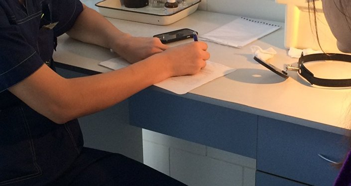 Архивное фото  пациента в кабинете у врача