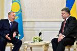 Нұрсұлтан Назарбаев пен Петр Порошенко. Архивтегі фото